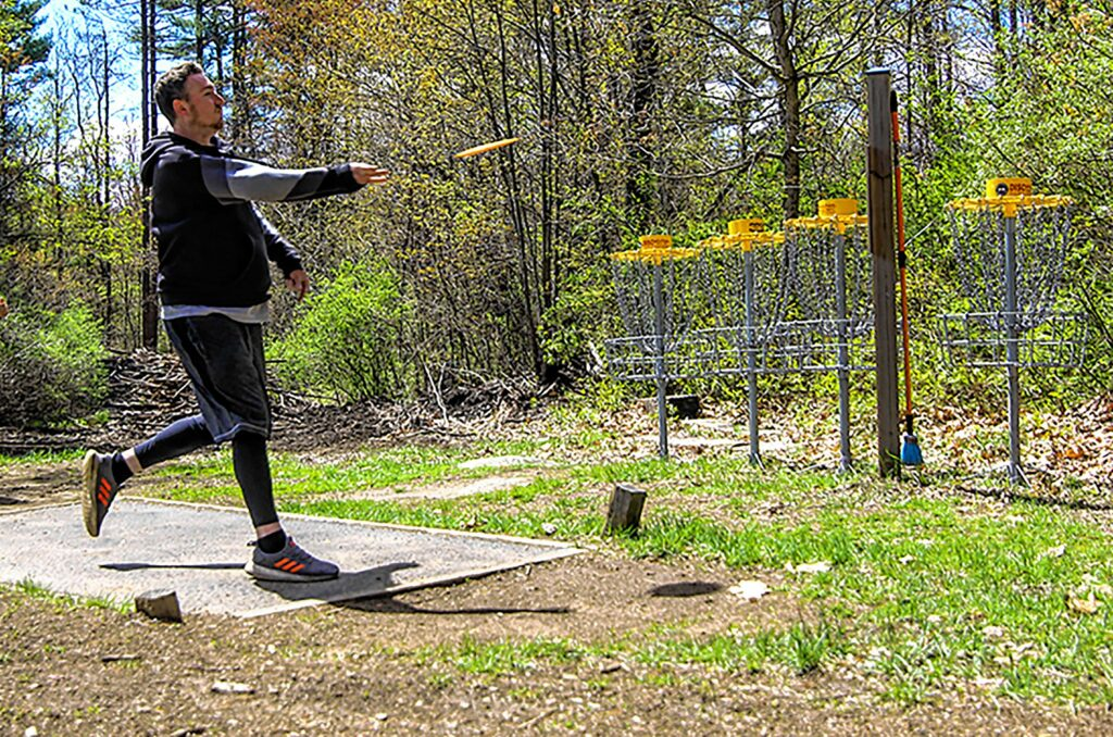 Scott White throwing a frisbee at Top O' The Hill Disc Golf in Canterbury on Thursday, May 6, 2021.MELISSA CURRAN
