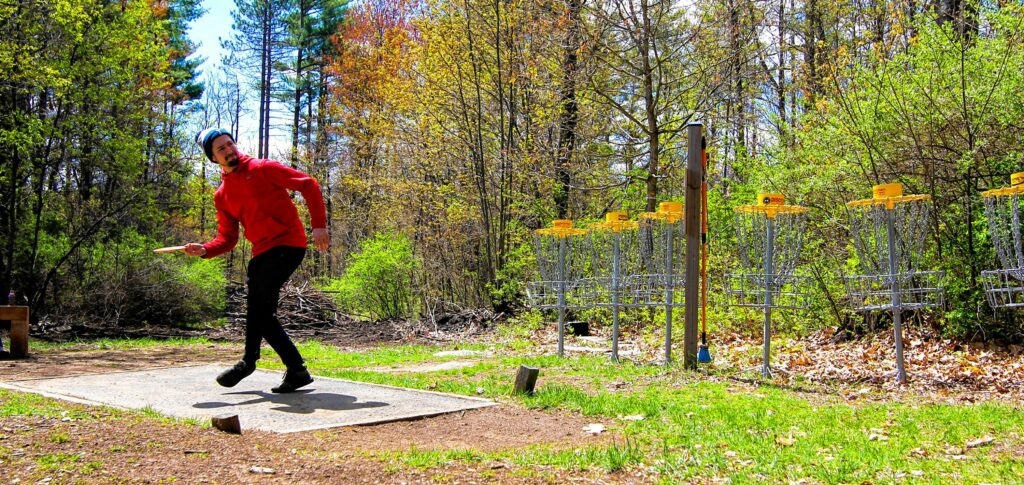 Michael Clark throwing a frisbee at Top O' The Hill Disc Golf in Canterbury on Thursday, May 6, 2021. MELISSA CURRAN